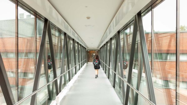 A student walking down the hallway on Lappeenranta Campus