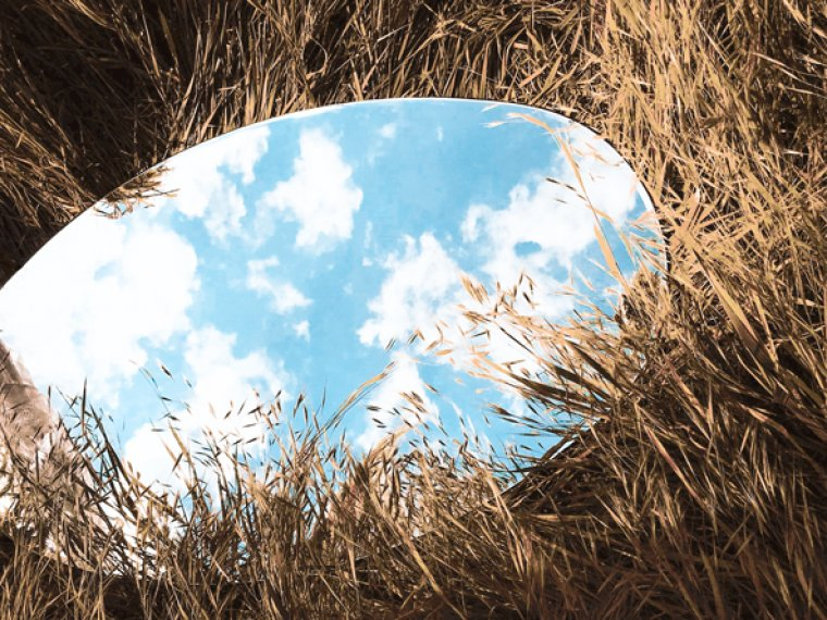 A round mirror on the ground